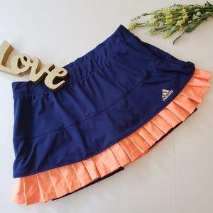 .Adidas. Navy tennis skort with orange ruffles